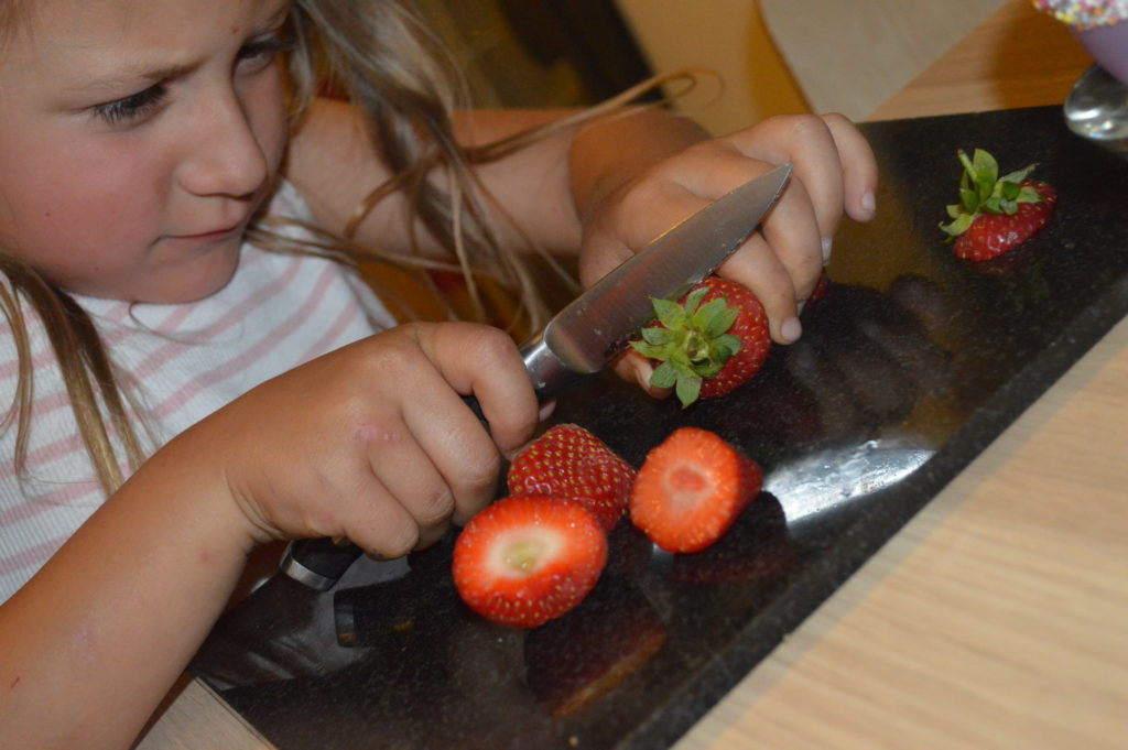 Chopping strawberries