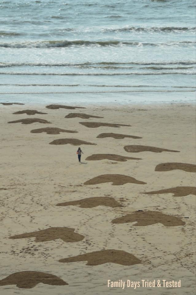 Dinosaur footprints beach art